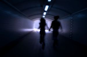 A man and a woman running away